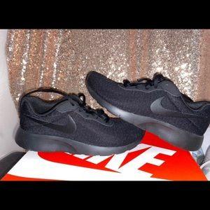 Brand new black NIKE Tanjuns shoes
